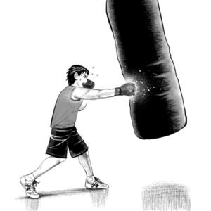 サンドバッグで練習をするボクサー